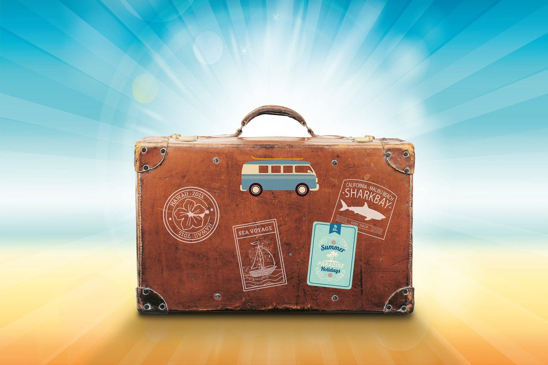 Suitcase pic for blog about medication safety tips for summer