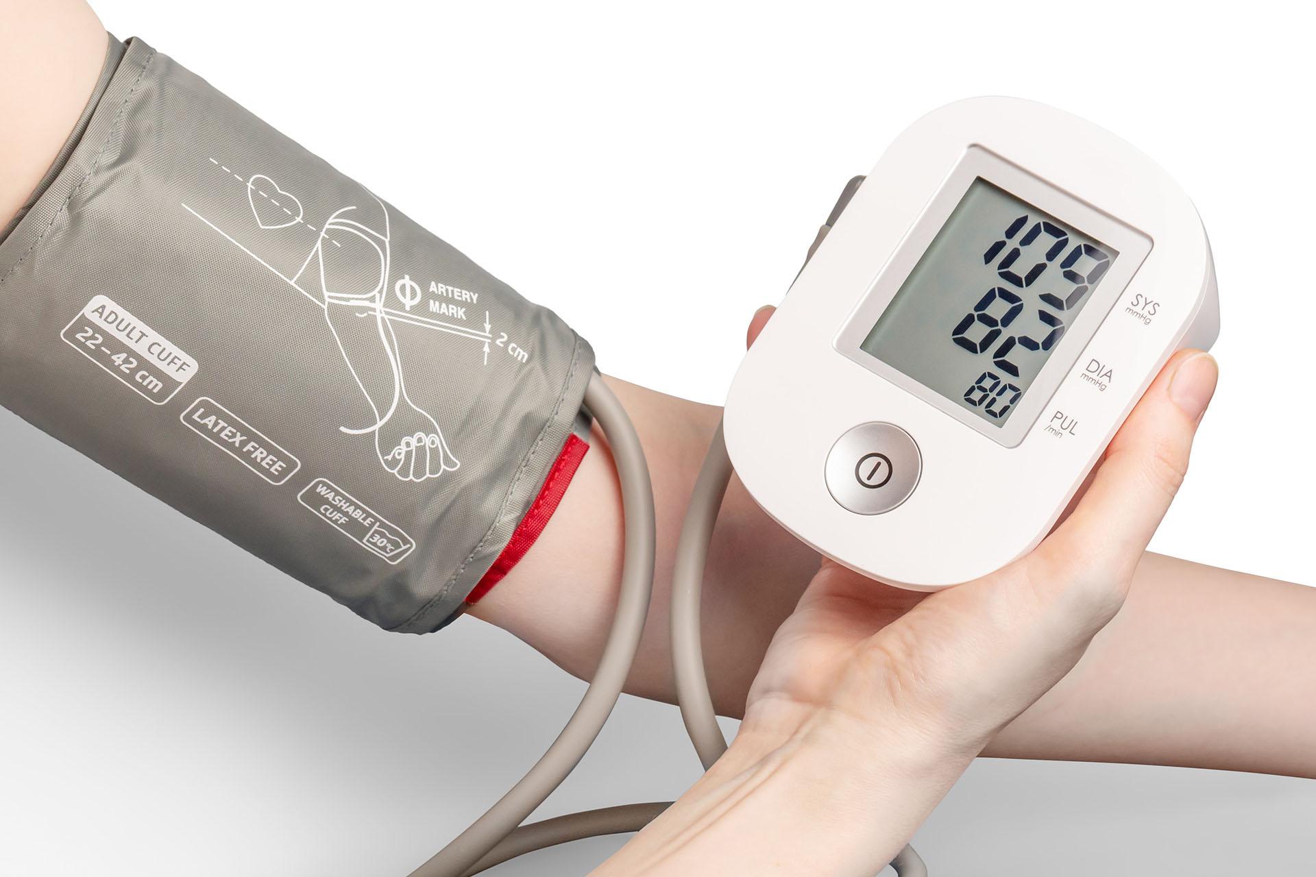 Picture of a person using a blood pressure cuff